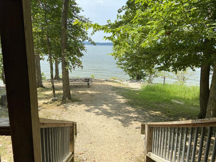 A photo of Site CA2 of Loop CABI at HARDIN RIDGE with Picnic Table, Electricity Hookup, Fire Pit, Shade, WaterfrontA photo of Site CA2 of Loop CABI at HARDIN RIDGE with Picnic Table, Electricity Hookup, Fire Pit, Shade, Waterfront The Lakeview is the view from your rocking chair on the front deck