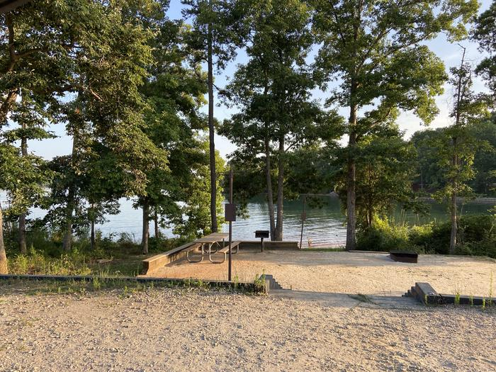 A photo of Site 73 of Loop SPRINGFIELD  at SPRINGFIELD with Picnic Table, Electricity Hookup, Fire Pit, Shade, Tent Pad, Waterfront, Lantern Pole, Water Hookup