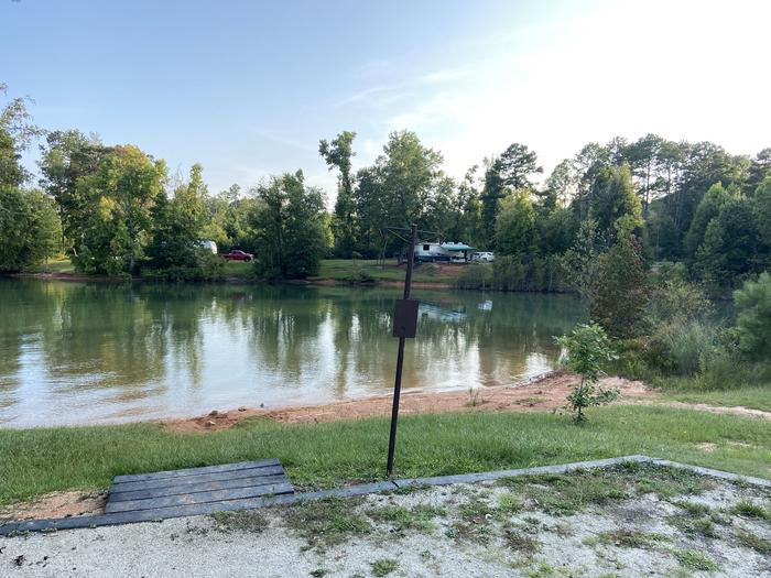 A photo of Site 67 of Loop SPRINGFIELD  at SPRINGFIELD with Picnic Table, Electricity Hookup, Fire Pit, Shade, Tent Pad, Waterfront, Lantern Pole, Water Hookup