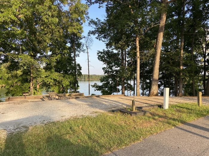 A photo of Site 75 of Loop SPRINGFIELD  at SPRINGFIELD with Picnic Table, Electricity Hookup, Fire Pit, Shade, Tent Pad, Waterfront, Lantern Pole, Water Hookup