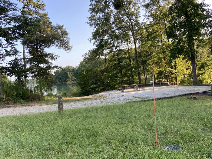 A photo of Site 71 of Loop SPRINGFIELD  at SPRINGFIELD with Picnic Table, Electricity Hookup, Fire Pit, Shade, Tent Pad, Waterfront, Lantern Pole, Water Hookup