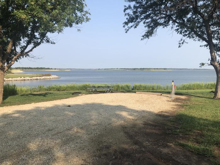 A photo of Site A-006 of Loop A at WEST ROLLING HILLS with Picnic Table, Electricity Hookup, Fire Pit, Waterfront, Water Hookup