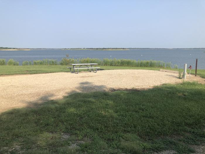 A photo of Site A-002 of Loop A at WEST ROLLING HILLS with Picnic Table, Electricity Hookup, Fire Pit, Waterfront, Water Hookup