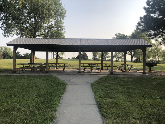 A photo of Site 5 of Loop EAST ROLLING HILLS PARK (KS) at EAST ROLLING HILLS PARK (KS) with Picnic Table, Lean To / Shelter
