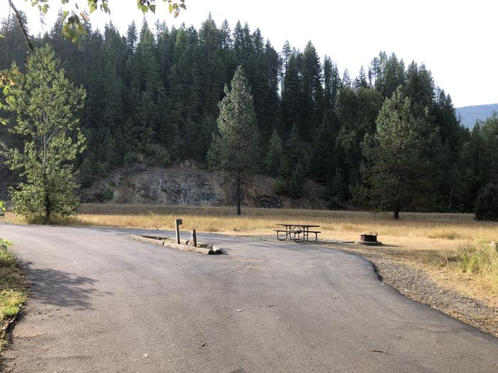 A photo of Site 25 of Loop A at Huckleberry Campground  with Picnic Table, Electricity Hookup, Fire Pit, Tent Pad, Water Hookup