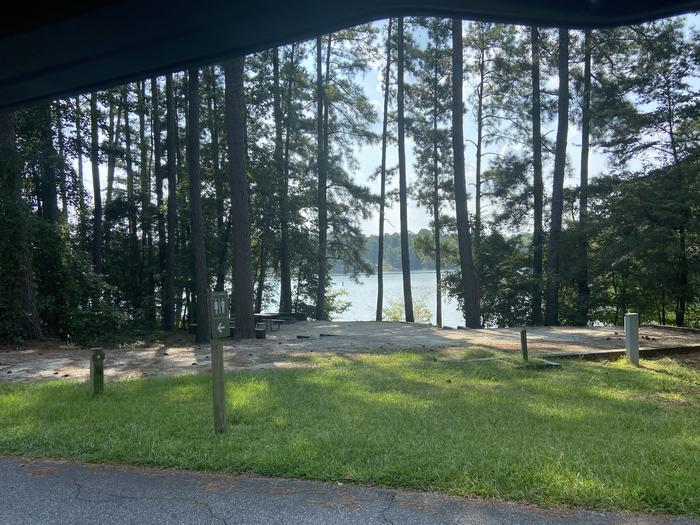 A photo of Site 04 of Loop SPRINGFIELD  at SPRINGFIELD with Picnic Table, Electricity Hookup, Fire Pit, Shade, Tent Pad, Waterfront, Lantern Pole, Water Hookup