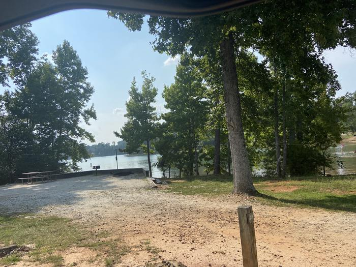 A photo of Site 28 of Loop SPRINGFIELD  at SPRINGFIELD with Picnic Table, Electricity Hookup, Fire Pit, Shade, Tent Pad, Waterfront, Lantern Pole, Water Hookup