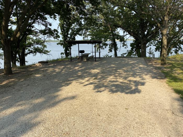 A photo of Site 15 of Loop CCRE at CANNING CREEK with Picnic Table, Electricity Hookup, Fire Pit, Shade, Waterfront, Water Hookup