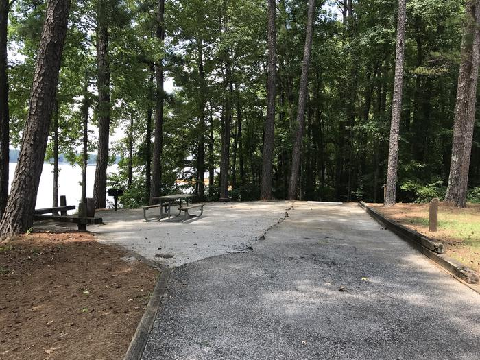 A photo of Site 082 of Loop LOOG at Holiday (Georgia) with Picnic Table, Electricity Hookup, Fire Pit, Shade, Tent Pad, Waterfront, Lantern Pole, Water Hookup
