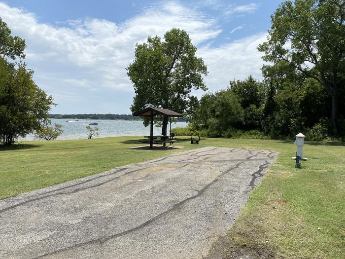 A photo of Site 085 of Loop HICKORY CREEK  at HICKORY CREEK with Boat Ramp, Picnic Table, Electricity Hookup, Fire Pit, Waterfront, Lantern Pole, Water Hookup, Lean To / Shelter