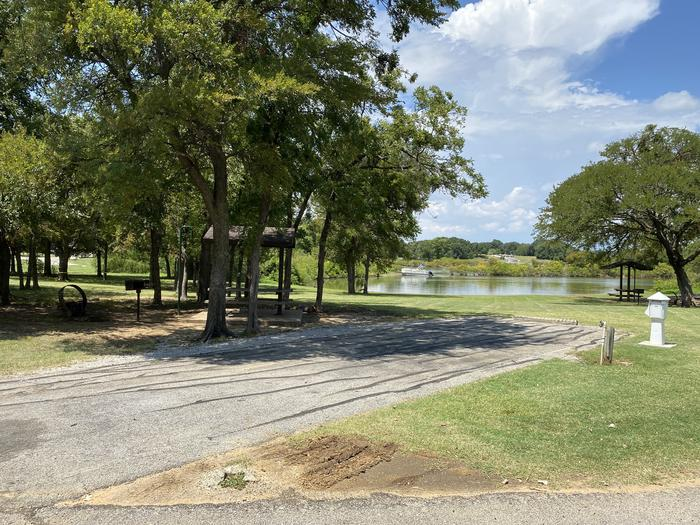 A photo of Site 086 of Loop HICKORY CREEK  at HICKORY CREEK with Boat Ramp, Picnic Table, Electricity Hookup, Fire Pit, Shade, Waterfront, Lantern Pole, Water Hookup, Lean To / Shelter