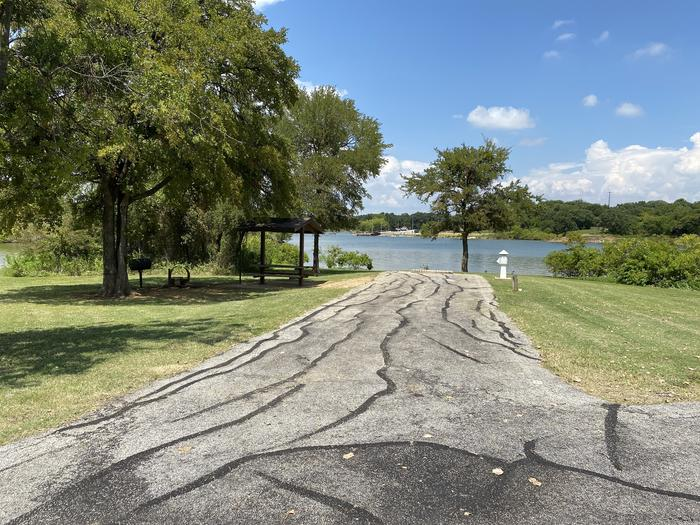 A photo of Site 092 of Loop HICKORY CREEK  at HICKORY CREEK with Boat Ramp, Picnic Table, Electricity Hookup, Fire Pit, Waterfront, Lantern Pole, Water Hookup, Lean To / Shelter