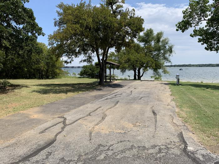 A photo of Site 089 of Loop HICKORY CREEK  at HICKORY CREEK with Boat Ramp, Picnic Table, Electricity Hookup, Fire Pit, Waterfront, Lantern Pole, Water Hookup, Lean To / Shelter