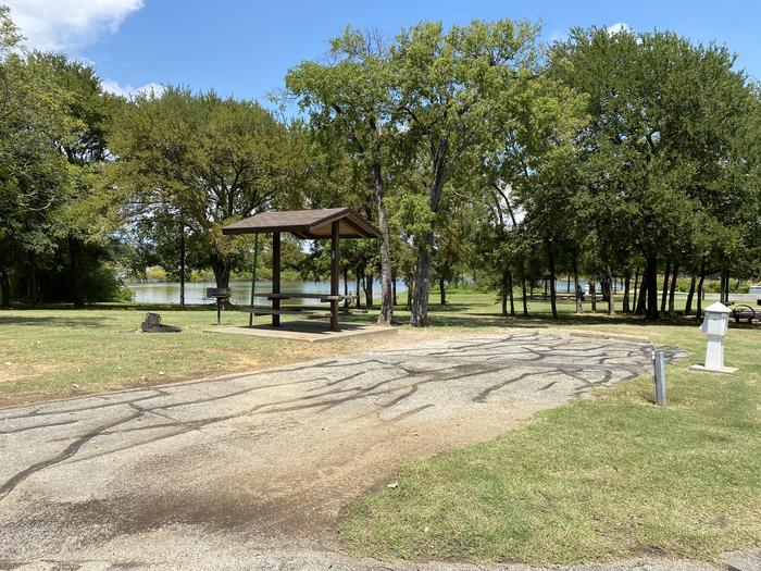 A photo of Site 084 of Loop HICKORY CREEK  at HICKORY CREEK with Boat Ramp, Picnic Table, Electricity Hookup, Fire Pit, Waterfront, Lantern Pole, Water Hookup, Lean To / Shelter
