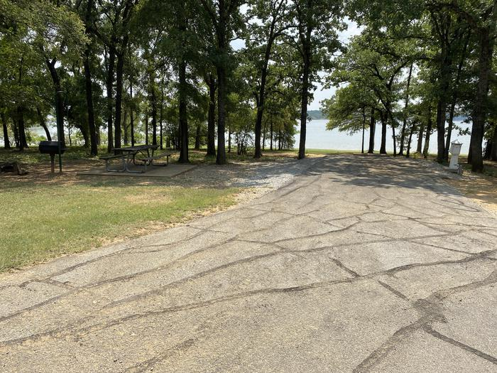 A photo of Site 033 of Loop HICKORY CREEK  at HICKORY CREEK with Boat Ramp, Picnic Table, Electricity Hookup, Fire Pit, Shade, Waterfront, Lantern Pole, Water Hookup