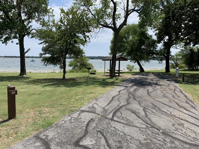 A photo of Site 088 of Loop HICKORY CREEK  at HICKORY CREEK with Boat Ramp, Picnic Table, Electricity Hookup, Fire Pit, Waterfront, Lantern Pole, Water Hookup, Lean To / Shelter