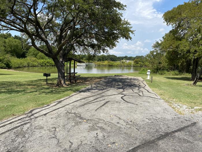 A photo of Site 093 of Loop HICKORY CREEK  at HICKORY CREEK with Boat Ramp, Picnic Table, Electricity Hookup, Fire Pit, Shade, Waterfront, Lantern Pole, Water Hookup, Lean To / Shelter
