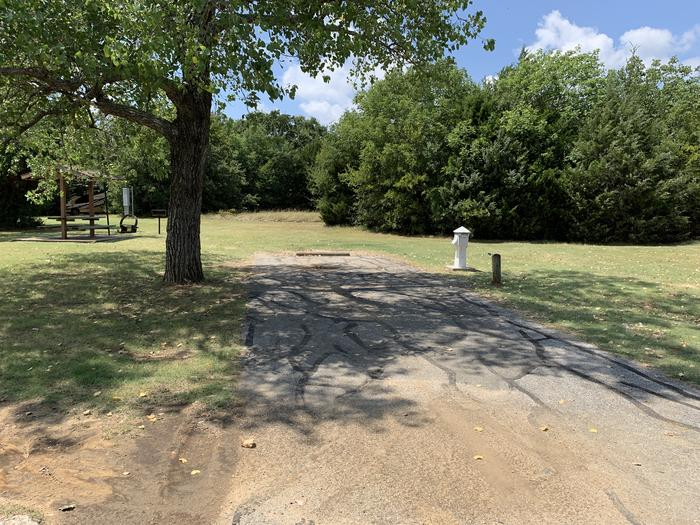 A photo of Site 051 of Loop HICKORY CREEK  at HICKORY CREEK with Boat Ramp, Picnic Table, Electricity Hookup, Fire Pit, Lantern Pole, Water Hookup, Lean To / Shelter