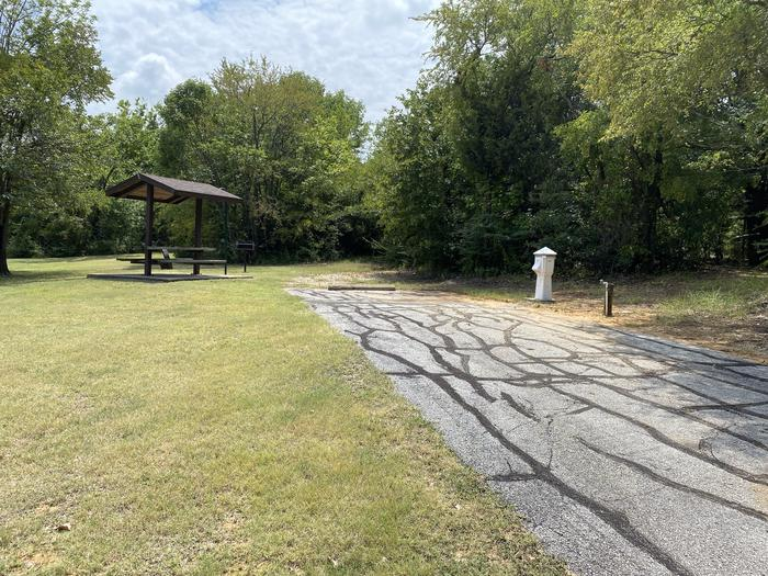 A photo of Site 061 of Loop HICKORY CREEK  at HICKORY CREEK with Boat Ramp, Picnic Table, Electricity Hookup, Fire Pit, Lantern Pole, Water Hookup, Lean To / Shelter