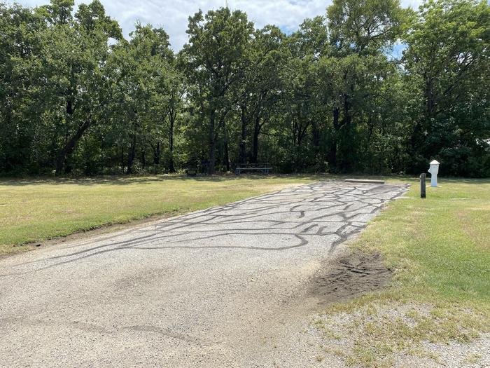 A photo of Site 103 of Loop HICKORY CREEK  at HICKORY CREEK with Boat Ramp, Picnic Table, Electricity Hookup, Fire Pit, Lantern Pole, Water Hookup