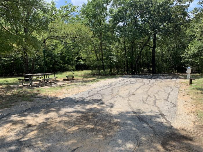 A photo of Site 098 of Loop HICKORY CREEK  at HICKORY CREEK with Boat Ramp, Picnic Table, Electricity Hookup, Fire Pit, Lantern Pole, Water Hookup, Lean To / Shelter