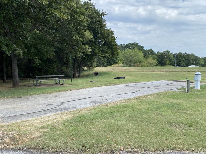 A photo of Site 107 of Loop HICKORY CREEK at HICKORY CREEK with Boat Ramp, Picnic Table, Electricity Hookup, Fire Pit, Lantern Pole, Water Hookup