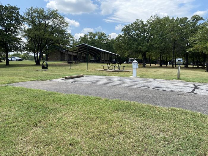 A photo of Site 111 of Loop HICKORY CREEK at HICKORY CREEK with Boat Ramp, Picnic Table, Electricity Hookup, Fire Pit, Lantern Pole, Water Hookup