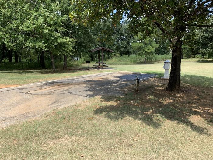 A photo of Site 064 of Loop HICKORY CREEK  at HICKORY CREEK with Boat Ramp, Picnic Table, Electricity Hookup, Fire Pit, Lantern Pole, Water Hookup, Lean To / Shelter