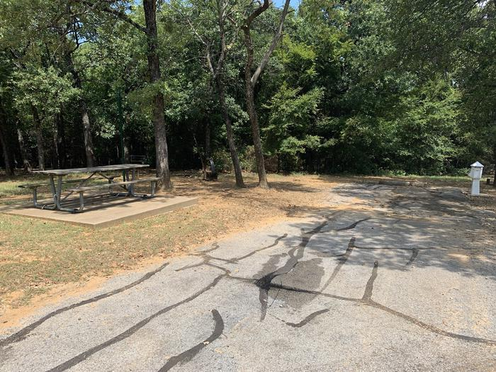 A photo of Site 113 of Loop HICKORY CREEK at HICKORY CREEK with Boat Ramp, Picnic Table, Electricity Hookup, Fire Pit, Lantern Pole, Water Hookup