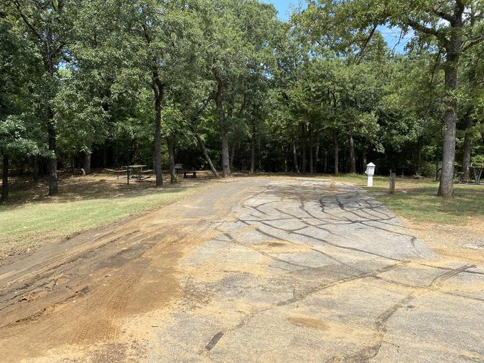 A photo of Site 115 of Loop HICKORY CREEK at HICKORY CREEK with Boat Ramp, Picnic Table, Electricity Hookup, Fire Pit, Shade, Lantern Pole, Water Hookup