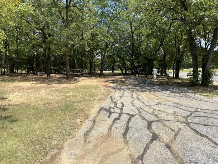 A photo of Site 095 of Loop HICKORY CREEK  at HICKORY CREEK with Boat Ramp, Picnic Table, Electricity Hookup, Fire Pit, Shade, Lantern Pole, Water Hookup, Lean To / Shelter