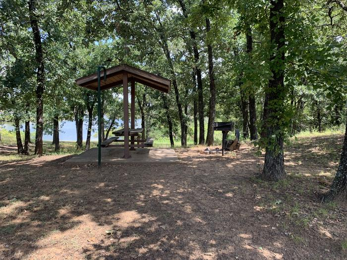 A photo of Site 076 of Loop HICKORY CREEK  at HICKORY CREEK with Picnic Table, Fire Pit, Lantern Pole, Lean To / Shelter