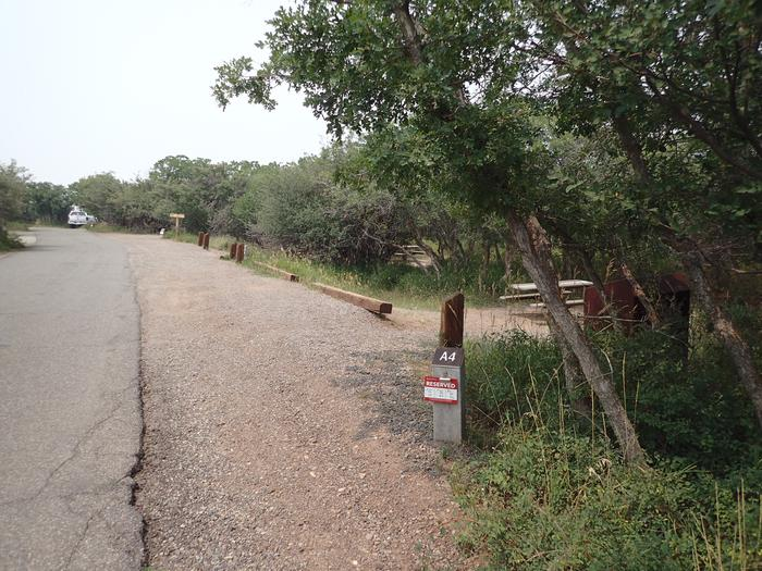 View of parking space for Campsite A-004