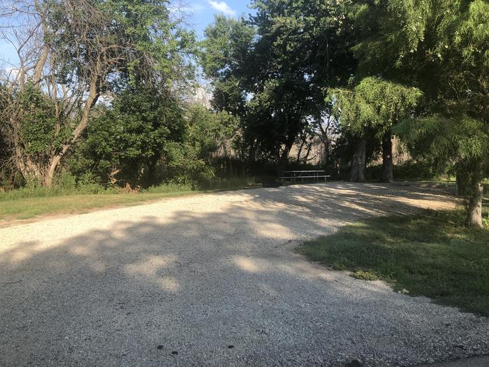 A photo of Site A-013 of Loop A at WEST ROLLING HILLS with Picnic Table, Electricity Hookup, Fire Pit, Shade, Water Hookup