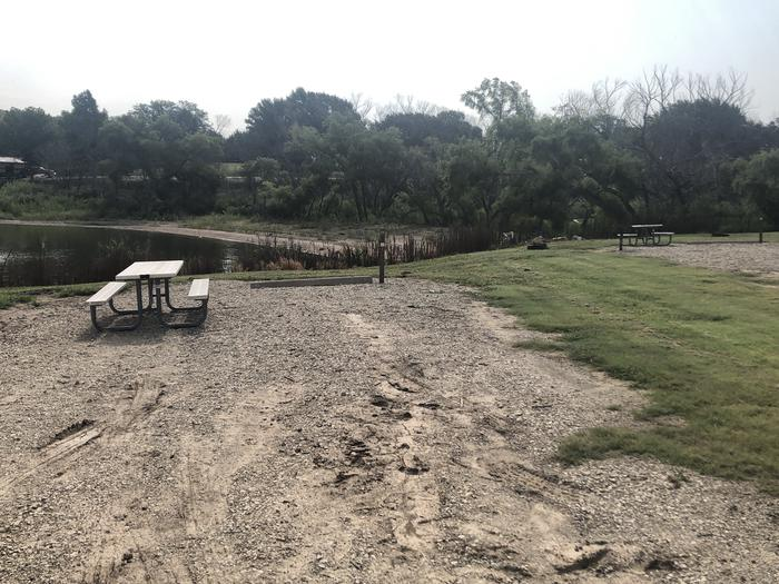 A photo of Site A-022 of Loop A at WEST ROLLING HILLS with Picnic Table, Fire Pit