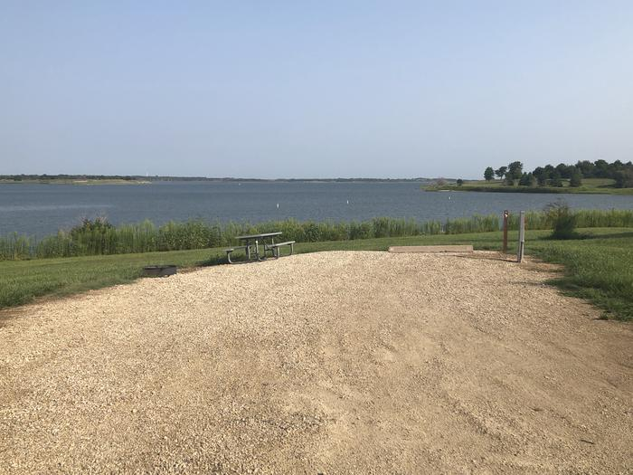 A photo of Site A-004 of Loop A at WEST ROLLING HILLS with Picnic Table, Electricity Hookup, Fire Pit, Waterfront, Water Hookup