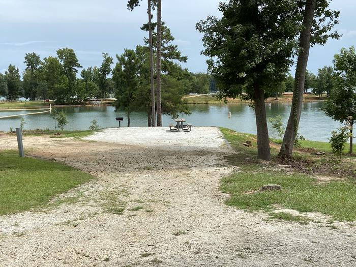 A photo of Site 21 of Loop SPRINGFIELD  at SPRINGFIELD with Picnic Table, Electricity Hookup, Fire Pit, Shade, Tent Pad, Waterfront, Lantern Pole, Water Hookup