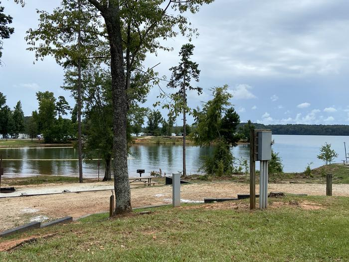 A photo of Site 23 of Loop SPRINGFIELD  at SPRINGFIELD with Picnic Table, Electricity Hookup, Fire Pit, Tent Pad, Waterfront, Lantern Pole, Water Hookup