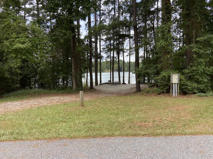 A photo of Site 06 of Loop SPRINGFIELD  at SPRINGFIELD with Picnic Table, Electricity Hookup, Fire Pit, Shade, Tent Pad, Waterfront, Lantern Pole, Water Hookup