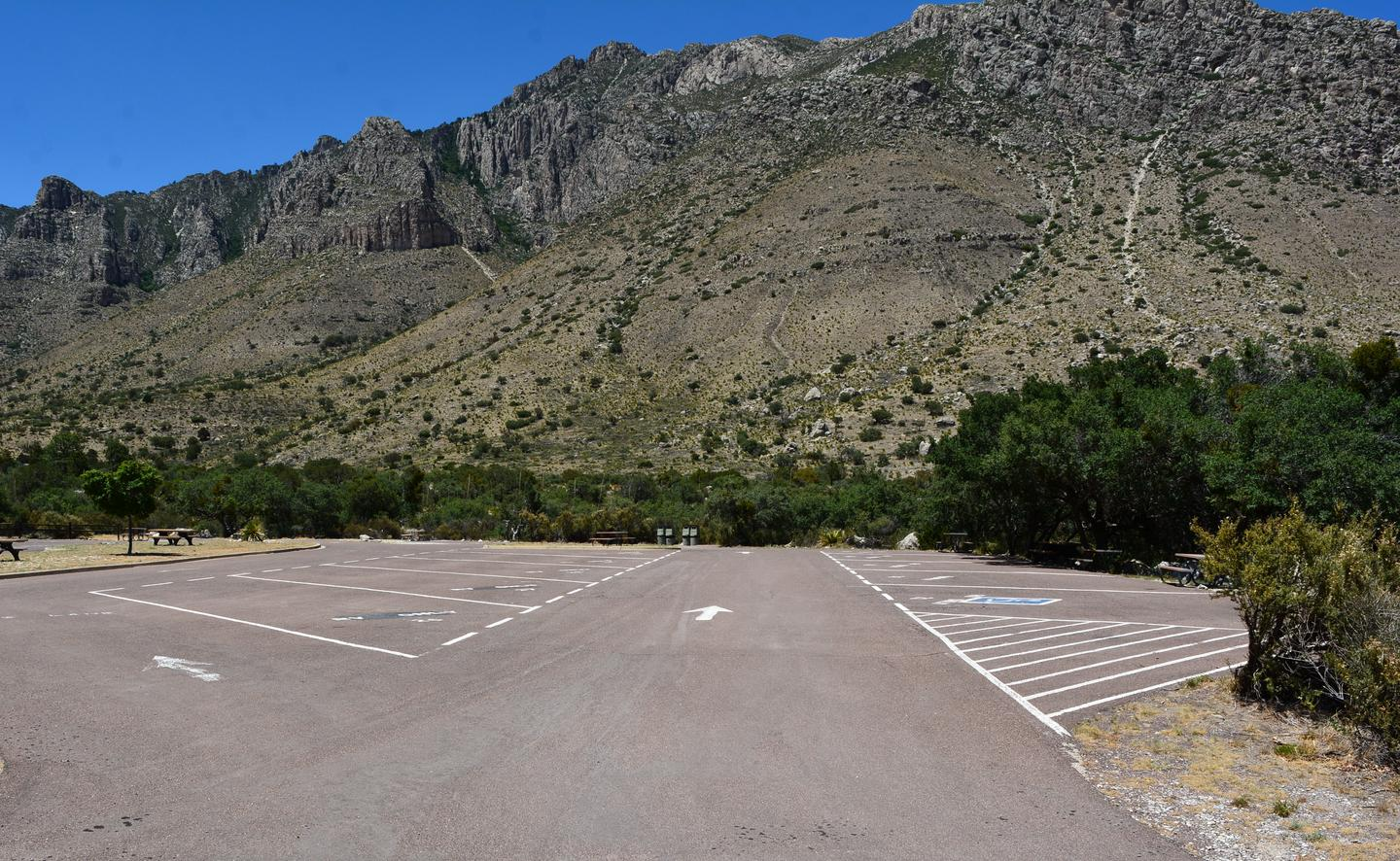 A view of RV campground parking area with sites 21-30 shown.  Site 23 is located along the right side of travel lane.  Mountain views in the background.A view of RV campground parking area with sites 21-30 shown.  Site 23 is located along the right side of travel lane.