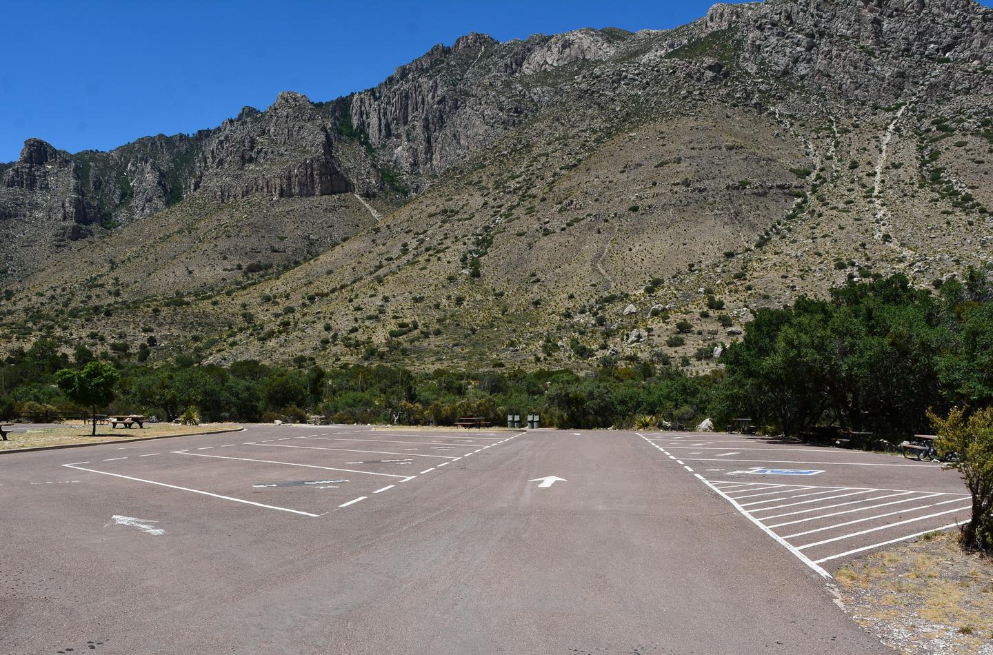 A view of RV campground parking area with sites 21-30 shown.  Site 25 is located along the right side of travel lane.  Mountain views in the background.A view of RV campground parking area with sites 21-30 shown.  Site 23 is located along the right side of travel lane, it is an end site and has only one RV site adjoining it.