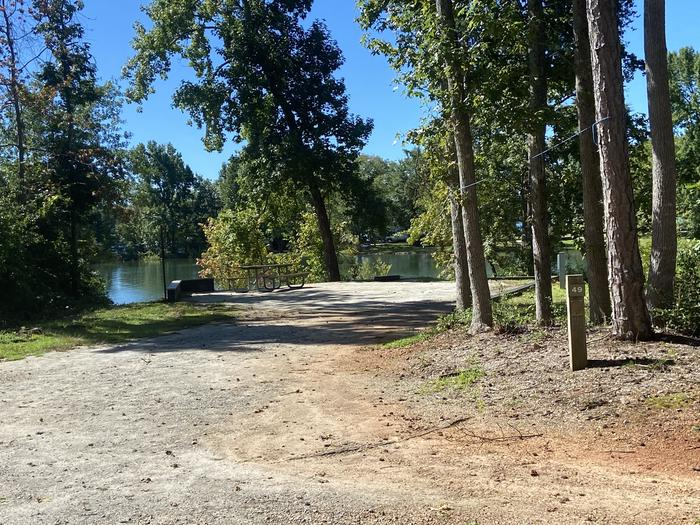 A photo of Site 49 of Loop SPRINGFIELD  at SPRINGFIELD with Picnic Table, Electricity Hookup, Fire Pit, Shade, Tent Pad, Waterfront, Lantern Pole, Water Hookup