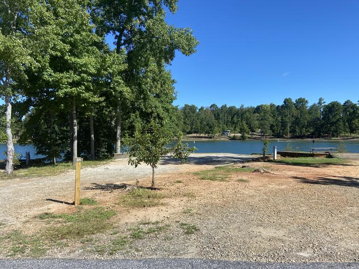 A photo of Site 31 of Loop SPRINGFIELD  at SPRINGFIELD with Picnic Table, Electricity Hookup, Fire Pit, Shade, Tent Pad, Waterfront, Lantern Pole, Water Hookup
