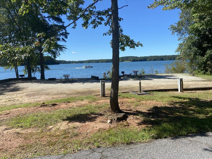 A photo of Site 41 of Loop SPRINGFIELD  at SPRINGFIELD with Picnic Table, Electricity Hookup, Fire Pit, Shade, Tent Pad, Waterfront, Lantern Pole, Water Hookup