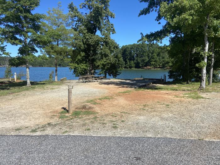 A photo of Site 32 of Loop SPRINGFIELD  at SPRINGFIELD with Picnic Table, Electricity Hookup, Fire Pit, Shade, Tent Pad, Waterfront, Lantern Pole, Water Hookup