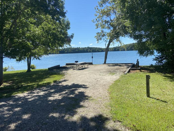 A photo of Site 38 of Loop SPRINGFIELD  at SPRINGFIELD with Picnic Table, Electricity Hookup, Fire Pit, Shade, Tent Pad, Waterfront, Lantern Pole, Water Hookup