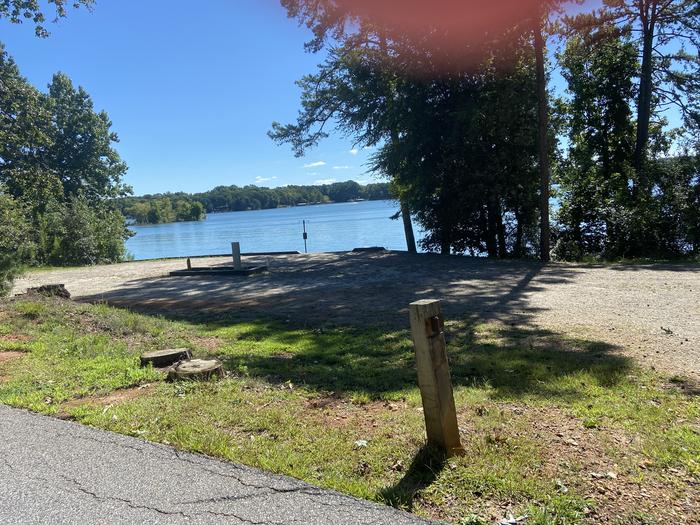 A photo of Site 54 of Loop SPRINGFIELD  at SPRINGFIELD with Picnic Table, Electricity Hookup, Fire Pit, Shade, Tent Pad, Waterfront, Lantern Pole, Water Hookup