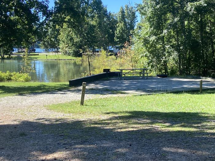 A photo of Site 47 of Loop SPRINGFIELD  at SPRINGFIELD with Picnic Table, Electricity Hookup, Fire Pit, Shade, Tent Pad, Waterfront, Lantern Pole, Water Hookup