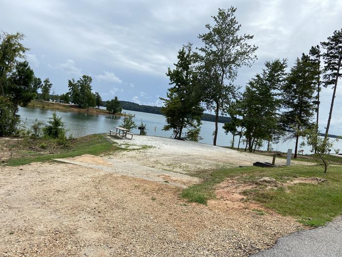 A photo of Site 22 of Loop SPRINGFIELD  at SPRINGFIELD with Picnic Table, Electricity Hookup, Fire Pit, Tent Pad, Waterfront, Lantern Pole, Water Hookup
