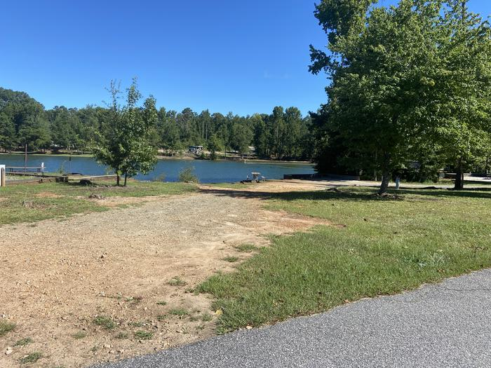 A photo of Site 29 of Loop SPRINGFIELD  at SPRINGFIELD with Picnic Table, Electricity Hookup, Fire Pit, Shade, Tent Pad, Waterfront, Lantern Pole, Water Hookup